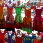 A row of colorful dresses in a market in Nimbin