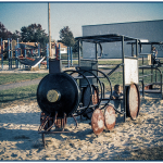An old playground with a metal bar train